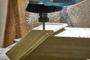 A CNC machine milling a piece of wood