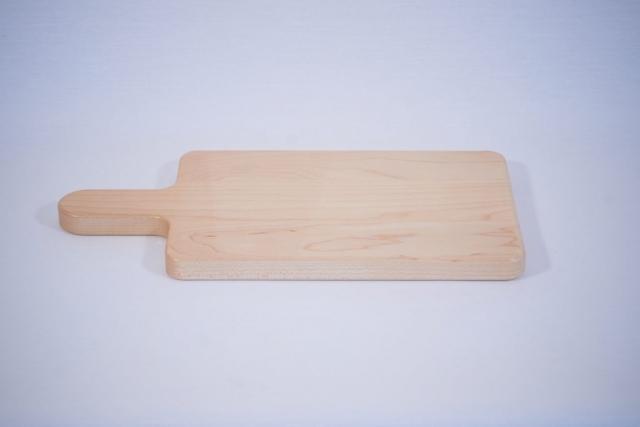 A maple cutting board cut by a CNC machine