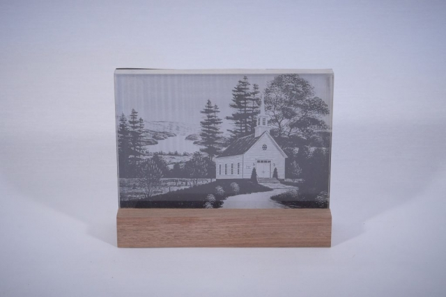A piece of acrylic engraved with a laser