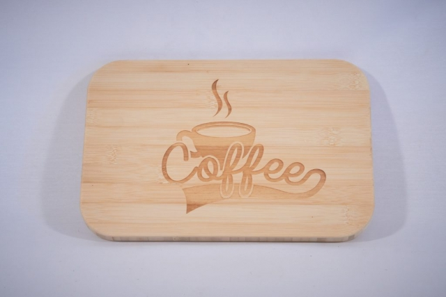 A bamboo cutting board with a laser engraving