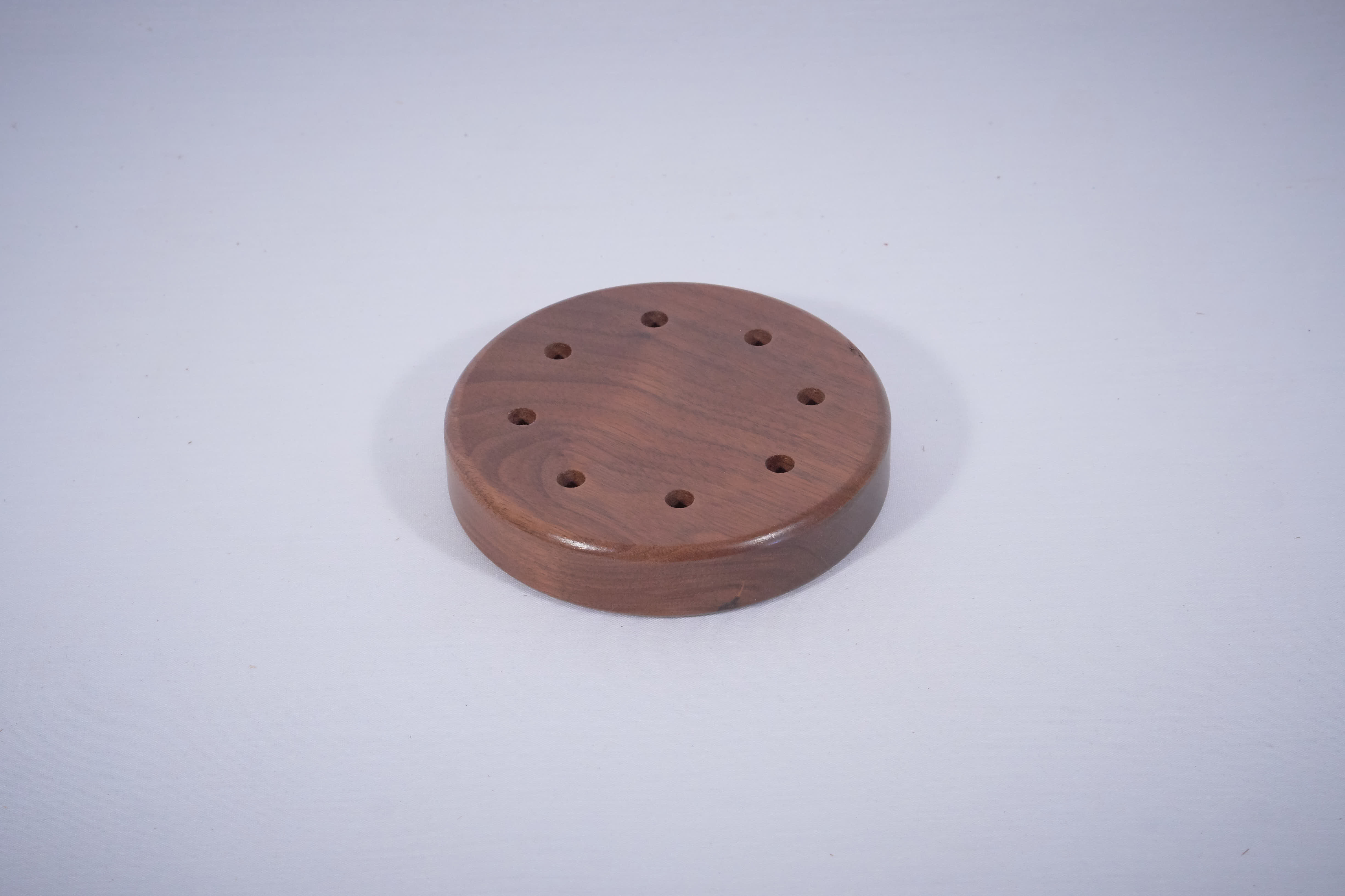 The outside of a turkey call cut by a CNC machine