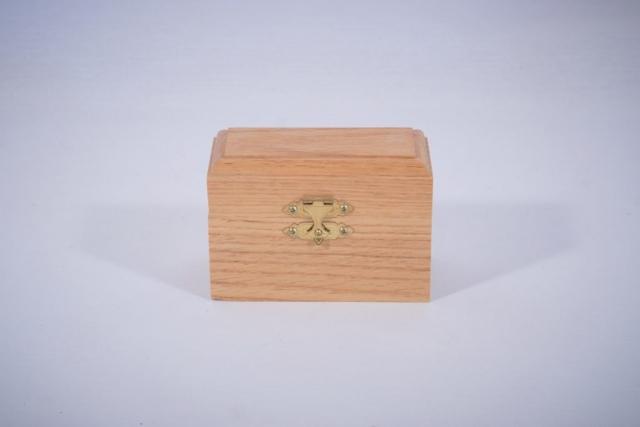 An oak box for storing drill bits