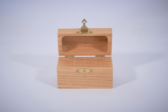 An oak box for storing drill bits